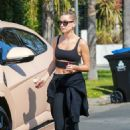 Hailey Bieber – In a workout top in West Hollywood