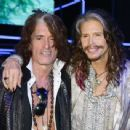 Joe Perry and Steven Tyler attend the Roberto Cavalli show during the Milan Menswear Fashion Week Spring Summer 2015 on June 24, 2014 in Milan, Italy