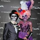 Jason and Naomi Priestley attend MAC Cosmetics and Rick Baker's Monster Mash in Glendale, Calif., on Oct. 19, 2013 - 399 x 600