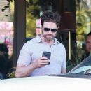 Gerard Butler is seen at Ollie's Duck & Dive Restaurant in Malibu, California on July 2, 2016
