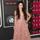 Vanessa Hudgens poses with adoptable puppies from The Shelter Pet Project during the 2015 MTV Video Music Awards at Microsoft Theater on August 30, 2015 in Los Angeles, California