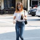 Actress and singer Lucy Hale stops by Starbucks in Los Angeles, California to pick up an iced coffee on August 24, 2016 - 454 x 599