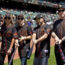 Kirk Hammett, Lars Ulrich, Robert Trujillo, and James Hetfield of the rock band Metallica stand on the field before the game between the San Francisco Giants and the Los Angeles Angels of Anaheim at AT&T Park on May 2, 2015 in San Francisco, California.