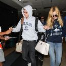 Bella Thorne and Gregg Sulkin arrive at LAX on August 4, 2015