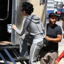 Katy Perry shows off a head full of curlers while on set in Los Angeles on June 4, 2013
