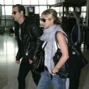 Jennifer Aniston & Justin Theroux's Heathrow PDA