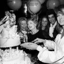 Farrah Fawcett cutting her birthday cat at New York New York. Her mother Polly is in the center