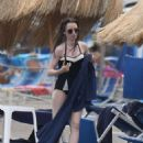 Lily Collins in Black Swimsuit at the Isabella hotel in Ischia