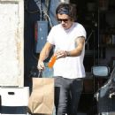Harry Styles showing off new tattoo in LA (February 24)