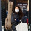 Katie Holmes – Christmas shopping at the store Rudy's Music in Soho