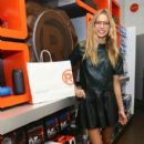 Jessica Hart attends the Charlotte Ronson Holiday Party At RadioShack Pop-Up Store in Times Square on December 12, 2013 in New York City