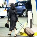 Dita Von Teese – Arrives at the airport in Miami - 454 x 467