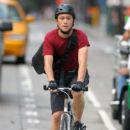 "Joseph Gordon-Levitt rides a bicycle as he films scenes for his upcoming film ""Premium Rush"""