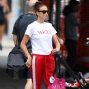 Irina Shayk in Bright Red Tracksuit Pants in NYC