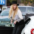 Iggy Azalea attracts a crowd of fans and photographers while stopping to fill up her white Ferrari in Westwood, California on January 16, 2015