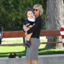 July 25, 2008 Actress Traylor Howard kicked off her heels and took a break from filming Monk with her adorable 20-month-old son Sabu on Wednesday – who was wearing a Dallas Cowboys jersey - 454 x 624