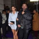 Irina Shayk in black shorts and high hills at the Universal Brits after party