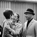 Audrey Hepburn greets her friends Yul Brynner and his wife Doris Kleiner at Cointrin AirPort in Geneva,Switzerland, April 9,1965. - 454 x 808