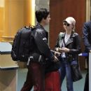 Lili Reinhart and Cole Sprouse- Arriving Back in Vancouver 01/10/2018 - 454 x 492