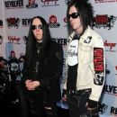 Musicians Joey Jordison of Slipknot (L) and Wednesday 13 of the Muderdolls arrive at the 2nd annual Revolver Golden Gods Awards held at Club Nokia on April 8, 2010 in Los Angeles, California. - 370 x 594