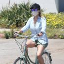 Reese Witherspoon – In denim shorts riding a bike in Malibu