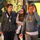 Leighton Meester shopping with her boyfriend Sebastian Stan and a friend at the Apple store in Hollywood. Los Angeles, California - 24.12.09
