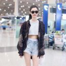 Ming Xi in Jeans Shorts at the Beijing Airport in China - 454 x 682