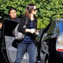 Emily Blunt leaves her Toyota Prius with the valet as she arrives at the Four Seasons Hotel in Beverly Hills