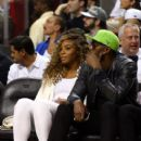Tennis player Serena Williams (L) and runner Usain Bolt (R) attend Game Four of the 2014 NBA Finals between the Miami Heat and the San Antonio Spurs at American Airlines Arena on June 12, 2014 in Miami, Florida. NOTE TO USER: User expressly acknowledges a