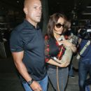 Salma Hayek Arriving On A Flight At Lax Airport In La