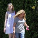 Elle Fanning takes her dog Lewellen on a walk in LA