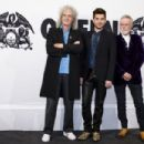 Brian May, Adam Lambert and Roger Taylor attend a photocall on the occasion of the musical project 'Queen & Adam Lambert' at Ritz Carlton on December 11, 2014 in Berlin, Germany - 454 x 303