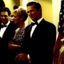 President Jackson Evans (Jeff Bridges, center) greets Senator Reginald Webster (Christian Slater) at a state dinner with his Vice Presidential designate Senator Laine Hanson (Joan Allen, left) and her husband William Hanson (Robin Thomas, far left), at hi - 400 x 265