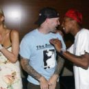 Socialite Paris Hilton, musicians Fred Durst and Pharrell Williams attend the launch party for 'Reebok's Billionaire Boys Club Apparel line and Ice Cream Footwear Collection' at Astra West on August 11, 2004 in Los Angeles, California.