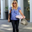 Reese Witherspoon is all smiles as she leaves her office in Beverly Hills, California on September 3, 2015