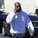 Kanye West has his hands full while attending a meeting in Calabasas, California on April 1, 2016 - 454 x 592
