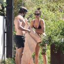 PICTURE EXCLUSIVE Irina Shayk displays her slender supermodel body in a black string bikini as she enjoys swim with shirtless hunky beau Bradley Cooper during romantic Lake Garda getaway - 454 x 539