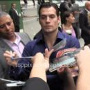 Henry Cavill signing autographs outside GMA