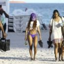Teyana Taylor enjoys a day on the beach with her daughter Iman Tayla Shumpert Jr. and other family members in Miami, Florida on January 18, 2017 - 454 x 266
