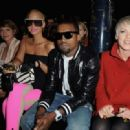 Amber Rose and Kayne West attend the Stella McCartney Ready-to-Wear A/W 2009 fashion show during Paris Fashion Week at Carreau du Temple in Paris, France -  March 9, 2009 - 454 x 319