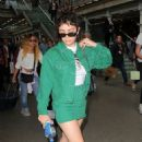Charli XCX in Green – Arriving at the Kings Cross St Pancras Station in London - 454 x 738