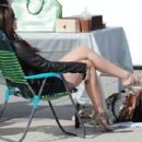 Emma Watson on location for the movie The Bling Ring on the Venice Boardwalk