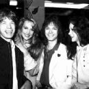 "Mick Jagger, Jerry Hall, Alan Merrill and Cathee Dahmen. Party at Mr. Chow restaurant New York in celebration of ""I Love Rock N Roll"" reaching #1 in 1982. Arrows lead singer Alan Merrill wrote and recorded the original 1975 Arrows version of ""I Love Rock"