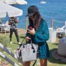 Adriana Lima in Blue Summer Dress at a beach club in Marbella