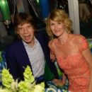 Mick Jagger and actress Laura Dern attend HBO's Annual Primetime Emmy Awards Post Award Reception at The Plaza at the Pacific Design Center on September 22, 2013 in Los Angeles, California - 454 x 417
