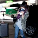 Selena Gomez gets a police escort as she prepares to depart LAX (Los Angeles International Airport) 4/30/2013 - 416 x 594