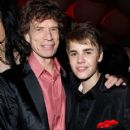 Mick Jagger and L'Wren Scott arrive at the Vanity Fair Oscar party hosted by Graydon Carter held at Sunset Tower on February 27, 2011 in West Hollywood, California - 420 x 612