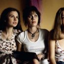 (Left to right) Polexia (Anna Paquin), Sapphire (Fairuza Balk) and Estrella (Bijou Phillips) are three of the 'band aids' following the Stillwater tour in Dreamworks' Almost Famous - 2000