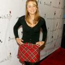 Megyn Price -  plaid skirt