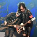 Nikki Sixx and DJ Ashba of Sixx:A.M. perform at The Joint inside the Hard Rock Hotel & Casino on April 10, 2015 in Las Vegas, Nevada - 454 x 359